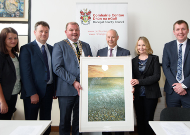 Dr. Peter FitzGerald being presented with a special gift of a painting of the Dorlin Beach, Loughris Point by Fionntan Gogarty, from Cllr. Ciaran Brogan, Cathaoirleach of Donegal County Council.  Also in the photo Cllr. Marie Therese Gallagher, Seamus Neely, Nuailin FitzGerald and Dr. Ciaran Richardson.
